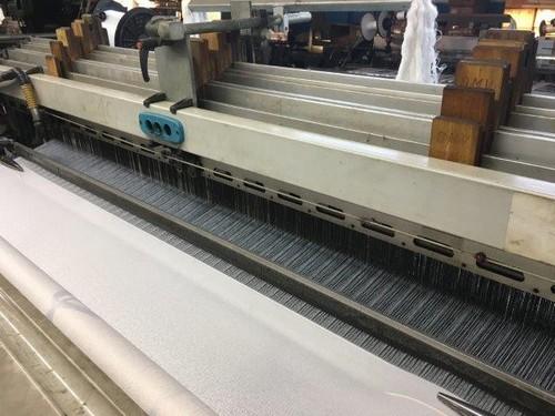 Distribuidor de tecidos para calças